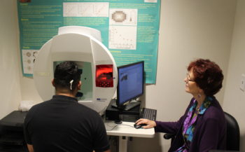 Researcher with patient at the visual field evaluation